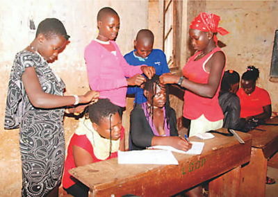 Mirembe Literacy Program - Learning to style hair