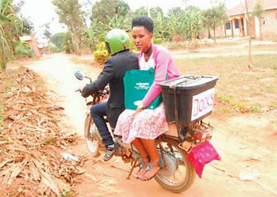 Mirembe Literacy Program - Riding the boda boda to deliver books
