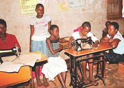 Mirembe Literacy Program - Learning to sew