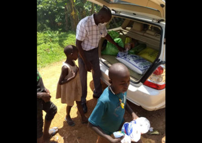 Special Feeding Program – Family with food supplies.